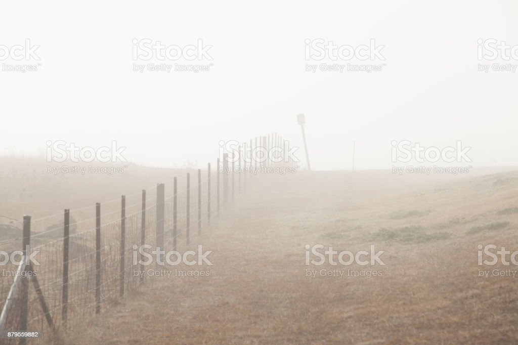 Winter Fog Morning along Fence Line and Sign stock photo