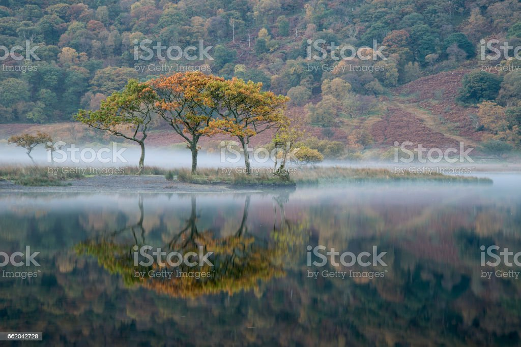 Winter foggy sunrise on Crummock Water in Lake District England royalty-free stock photo
