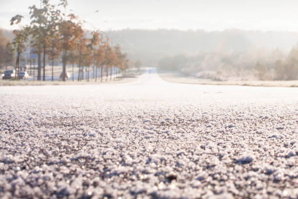 Winter frozen road close up. stock photo