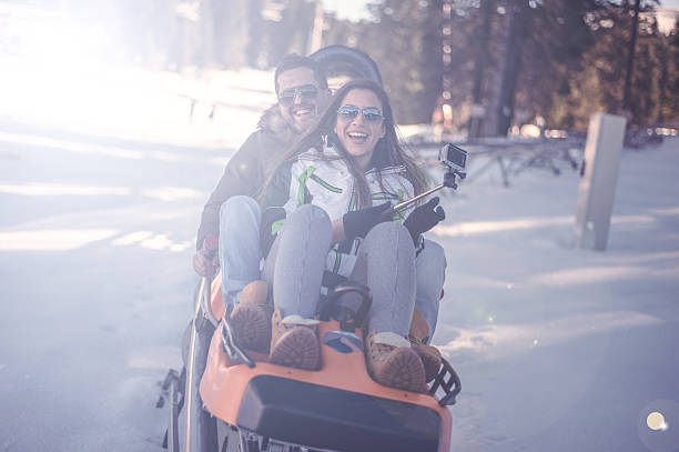 Winter fun on bobsled stock photo