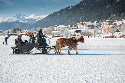 Winter fun on the Weissensee in the Alps