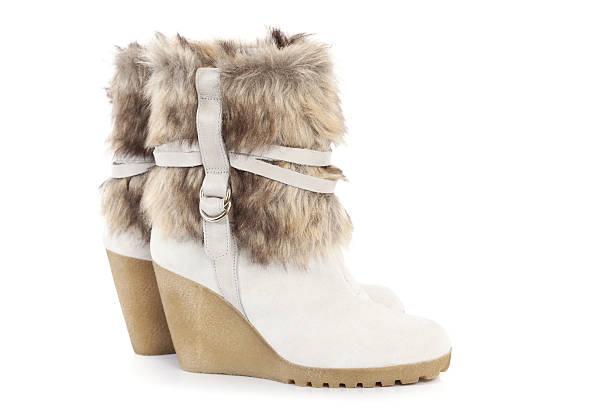 winter-boots - lammfellstiefel stock-fotos und bilder