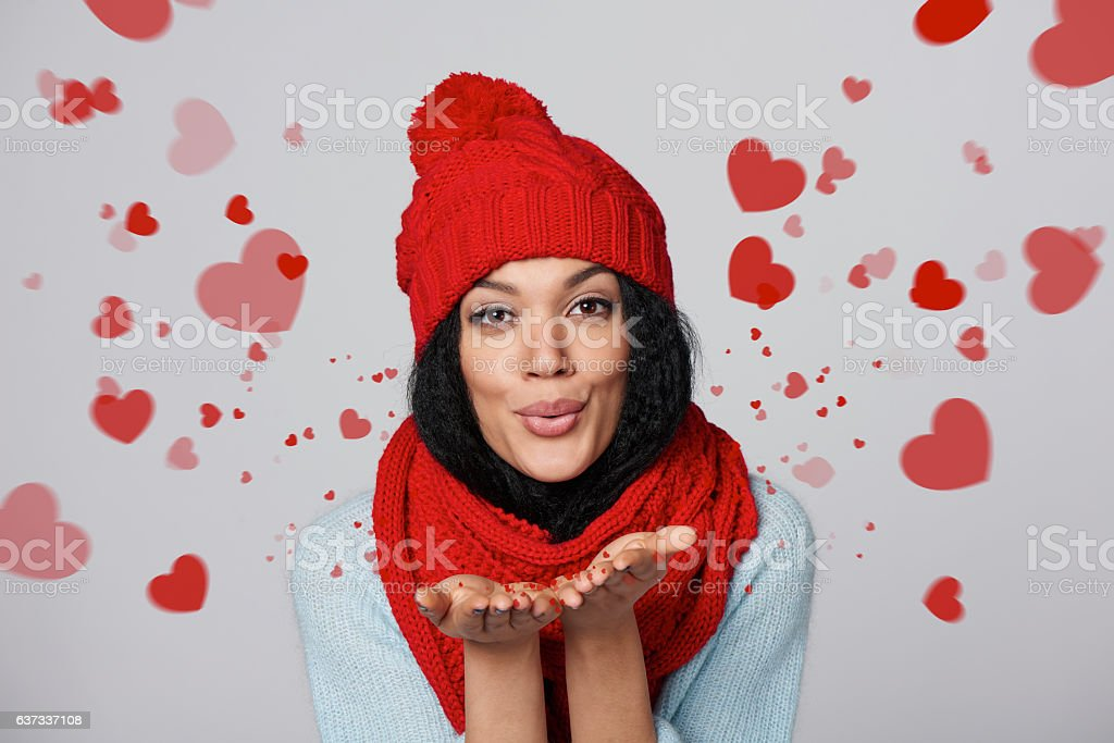 Winter girl blowing a kiss stock photo
