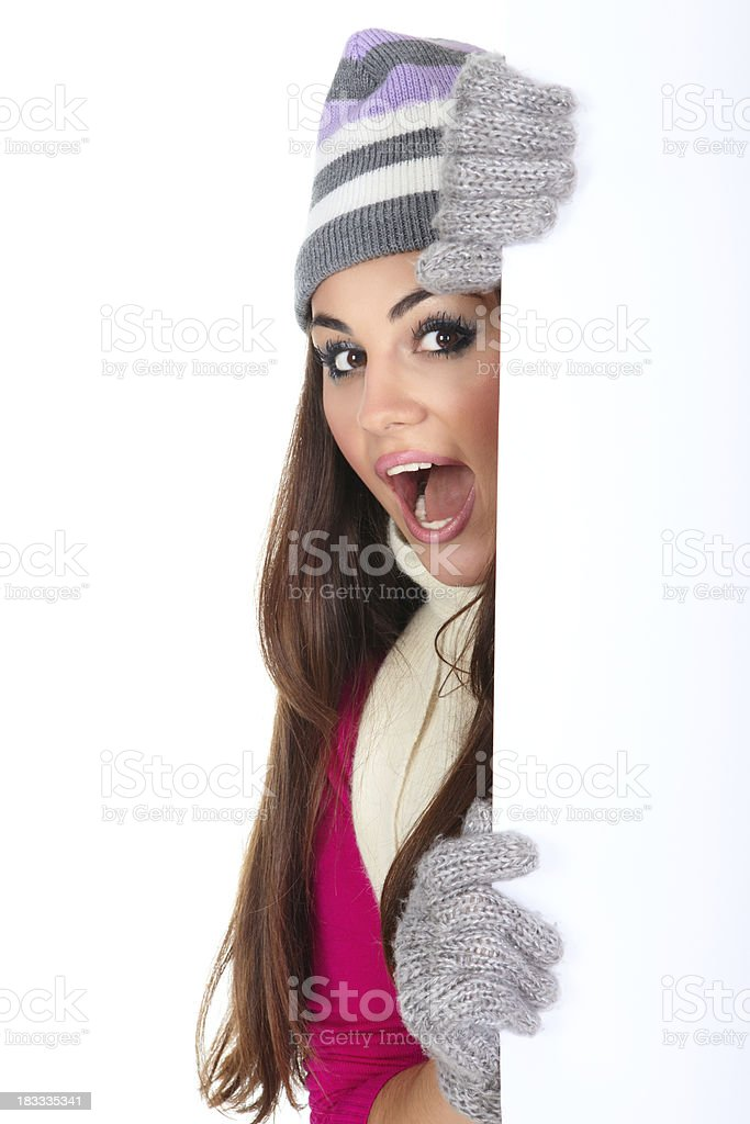 Winter girl holding blank paper royalty-free stock photo