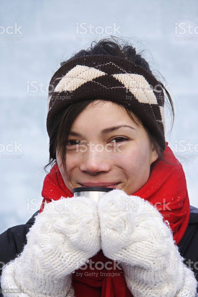 Winter girl in cold weather drinking hot tea royalty-free stock photo