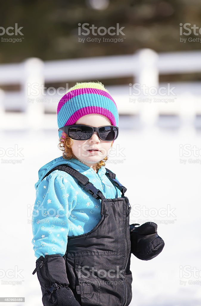 77bbcaec097 Winter Girl Wearing Sunglasses Stock Photo   More Pictures of 2-3 ...