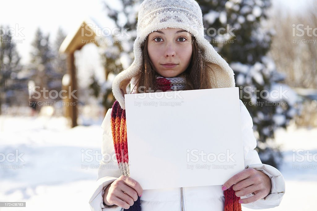 Winter. Girl with blank banner. royalty-free stock photo