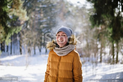 Portrait of a woman in a winter forest