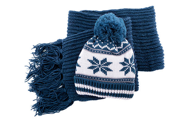 Winter hat and scarf Blue knitted winter bobble hat and scarf isolated against a white background.  Alternative file shown below: headscarf stock pictures, royalty-free photos & images