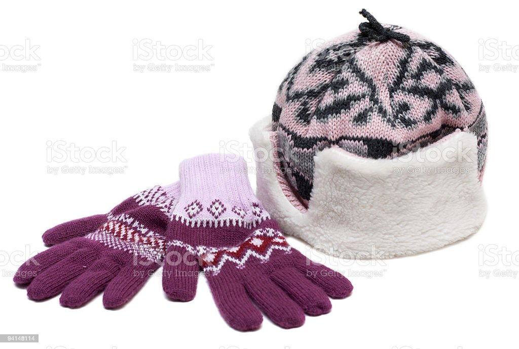 Winter hat with fur and violet gloves royalty-free stock photo
