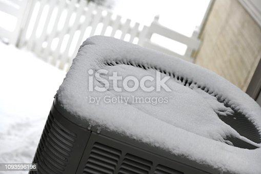 Fresh snow on top of a heat pump.