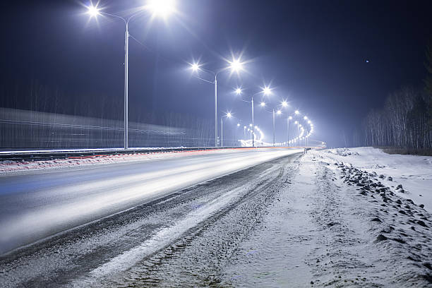 winter highway at night stock photo