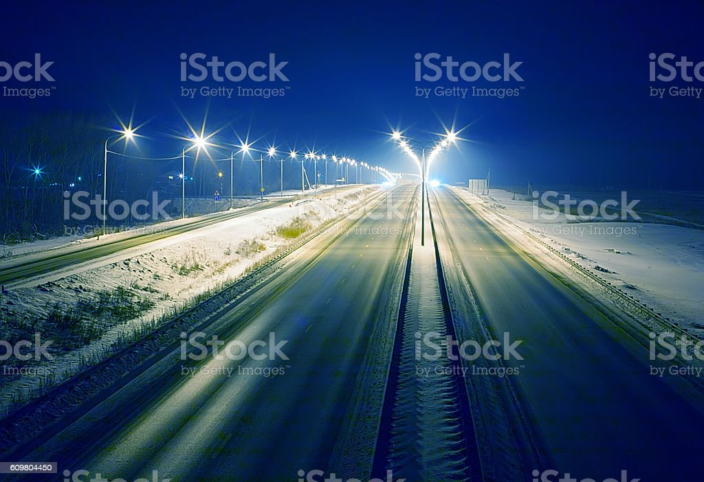 winter highway at night stock photo