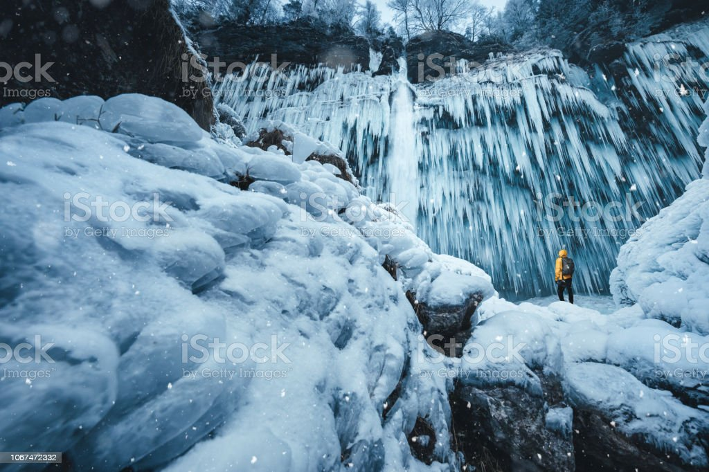 Winter Hike At The Frozen Waterfall stock photo