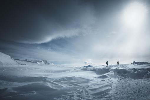Two people hiking on idyllic winter day (Dachstein Krippenstein, Austria).