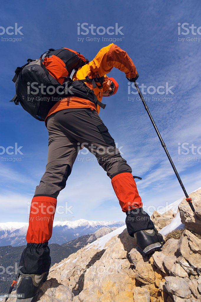 Winter hiking in the mountains with a backpack. royalty-free stock photo