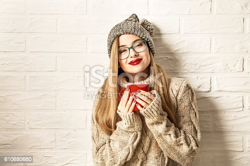 istock Winter Hipster Girl Enjoying a Cup of Hot Tea 610680680