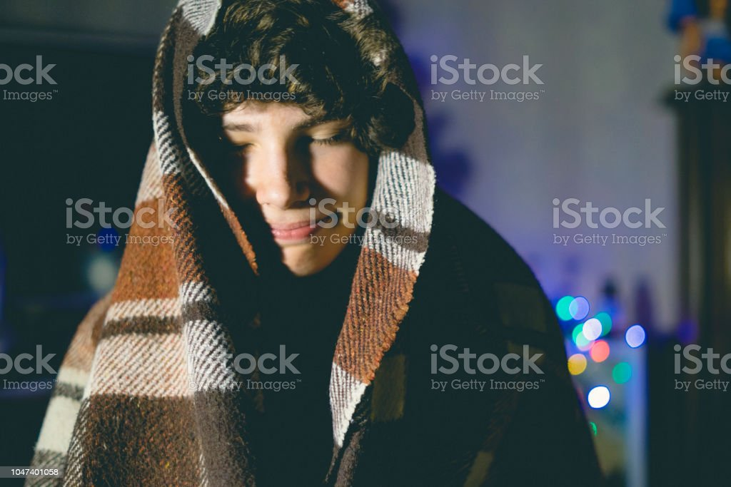 winter holdiays night at cozy home under the blanket feeling relax...