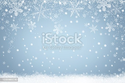 Winter holiday snow background design with snowflakes. Abstract light blue Christmas backdrop