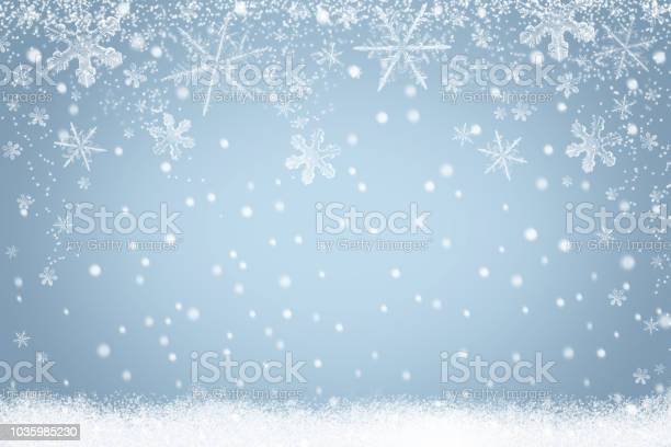 Photo of Winter holiday snow background with snowflakes for design