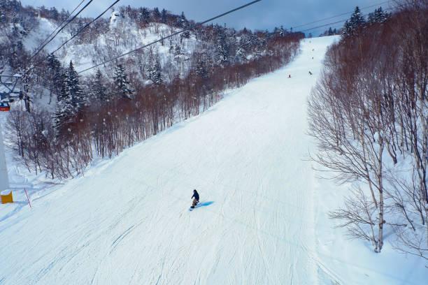 winter holidays skiing at sapporo kokusai, hokkaido, japan. - sapporo stock photos and pictures