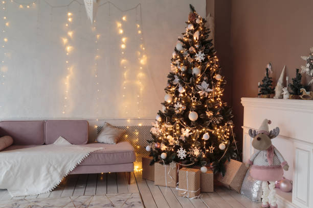 Winter home decor. Christmas tree in loft interior. Old vintage furniture stock photo