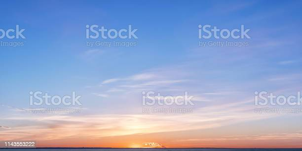 Photo of Winter horizon at sunset with bright colored clouds