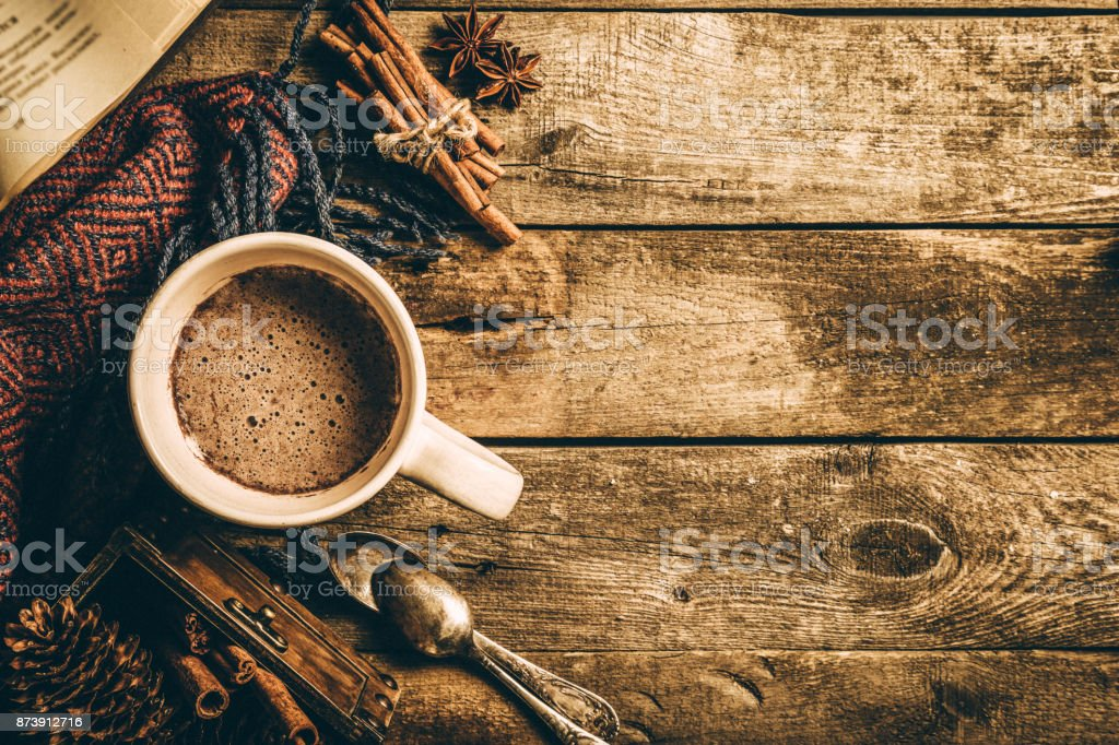 Winter hot chocolate on rustic background stock photo