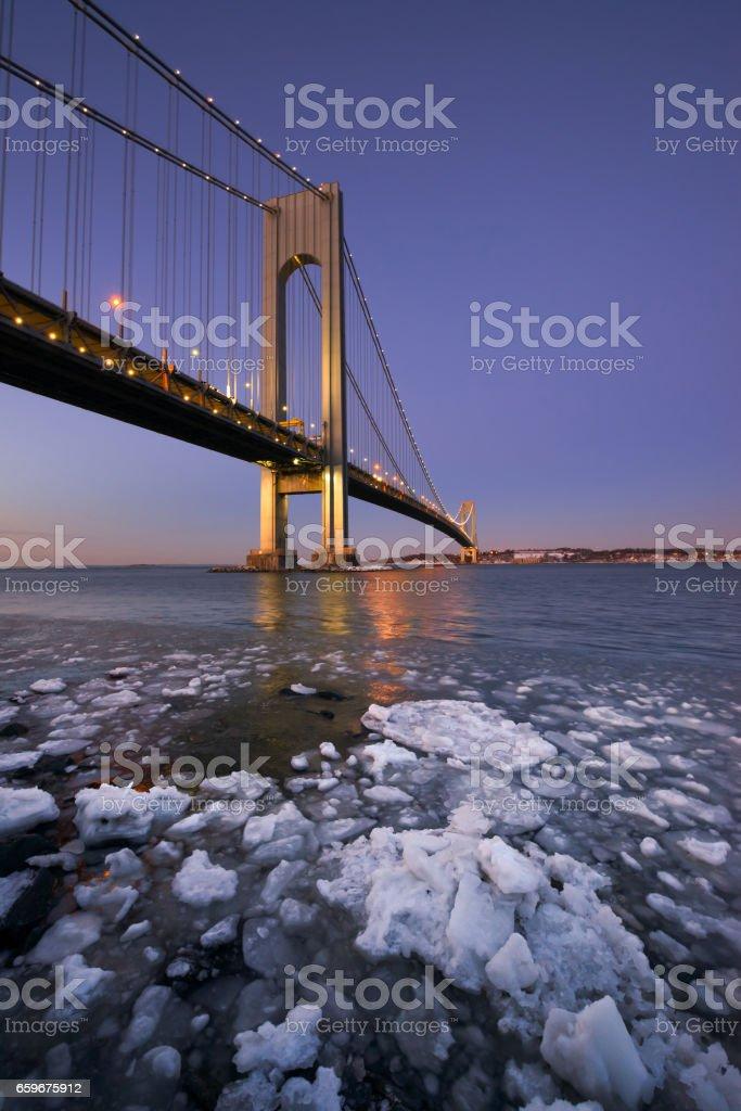 Winter ice near Verrazano Bridge stock photo