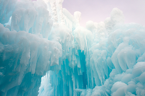 Frozen blue water ice castle view from below