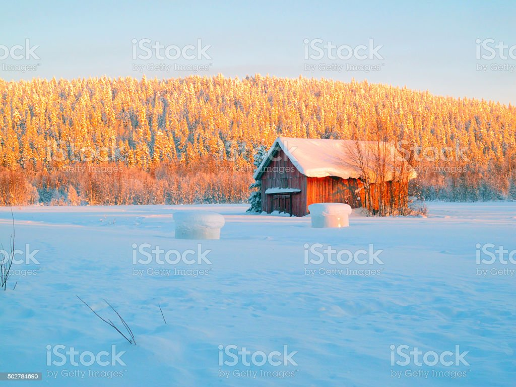 winter image of a hay barn stock photo