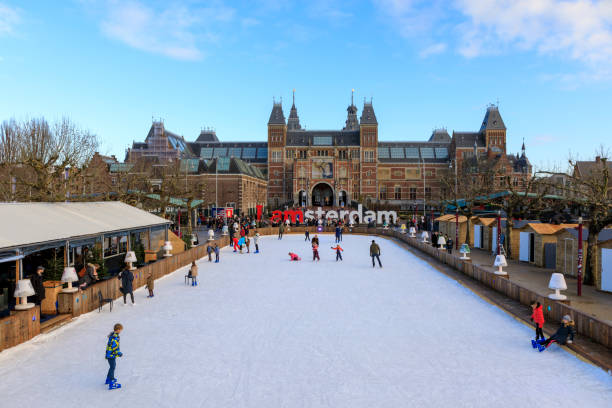 Winter in Amsterdam at the Rijksmuseum Amsterdam / Netherlands - Dec 16 2017: Panorama of the ice rink during the winter at Museumplein. In the background you can see the Rijksmuseum with words I Amsterdam. museumplein stock pictures, royalty-free photos & images
