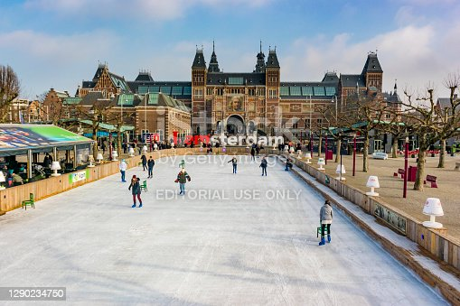 People skating on an ice rink in front of the Rijksmuseum in Amsterdam, the capital of The Netherlands.