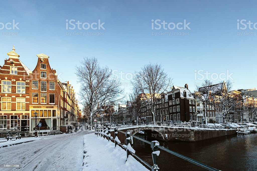 Winter in Amsterdam; the streets are covered with snow stock photo