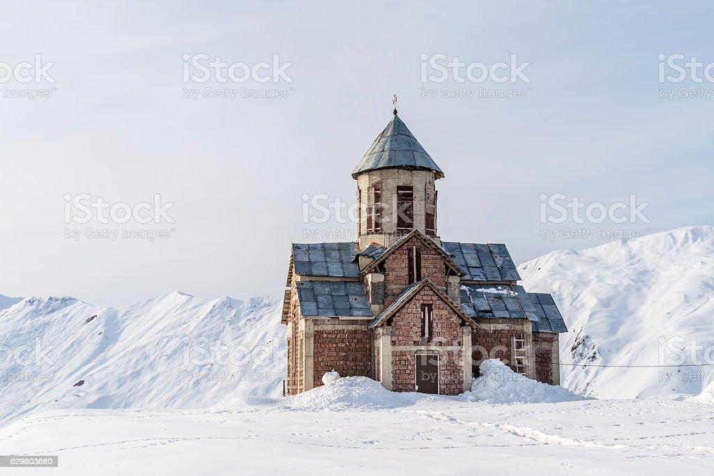 Winter in Greater Caucasus Mountains. Georgian orthodox church. stock photo