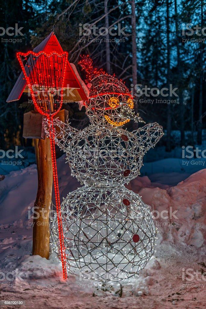 Winter in High Tatras Mountains. Illuminated snowman. royalty-free stock photo