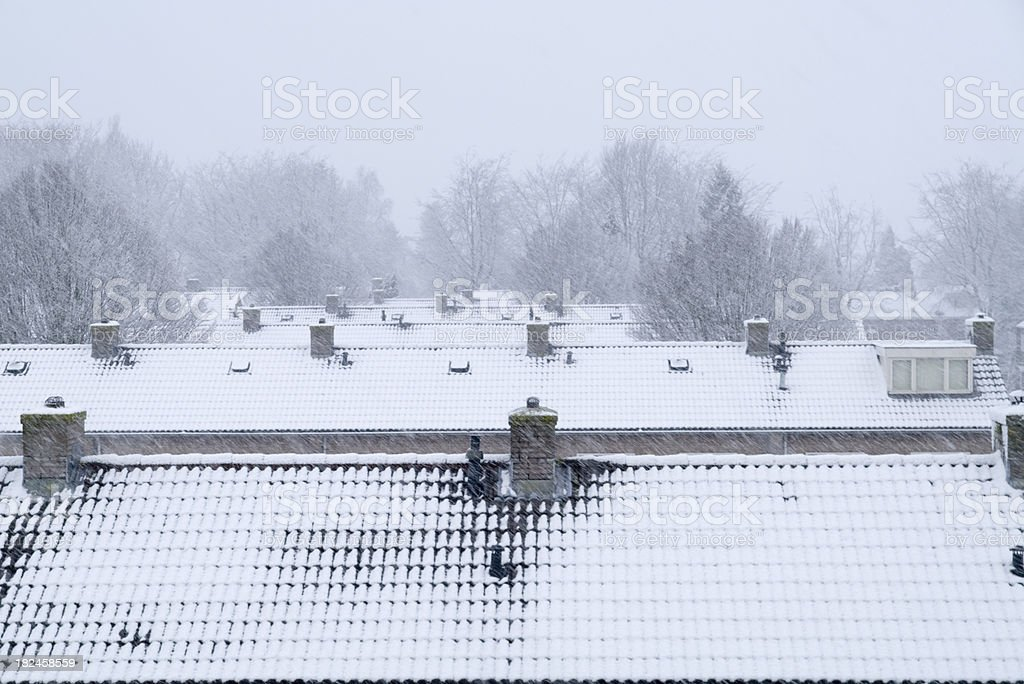 Winter in Holland: Rooftops & Chimneys with Snow royalty-free stock photo