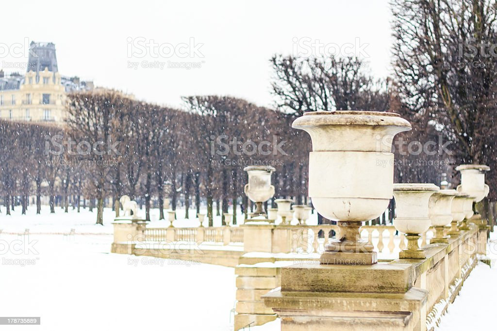 Winter in Luxembourg garden, Paris Winter in Paris / Luxembourg garden covered with snow Ancient Stock Photo