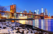 New York City Manhattan skyline and Brooklyn Bridge along the East River in winter