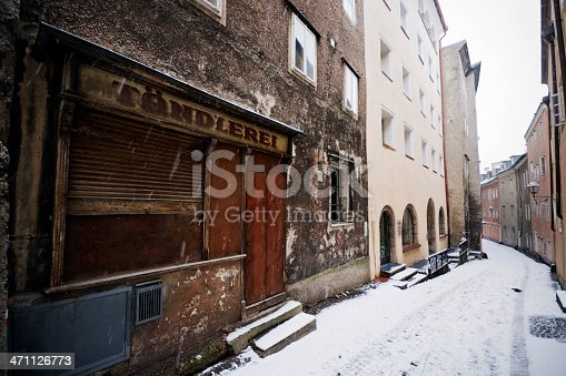 Wide-angle and high-contrast photo of a narrow alleyway in Salzburg, Austria. A