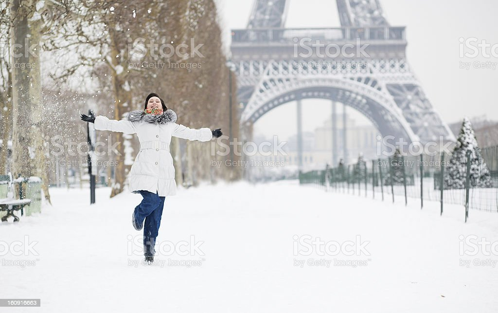 Winter in Paris. Happy young girl jumping royalty-free stock photo