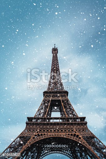 Eiffel Tower on snowy winter morning (Paris, France). View from below.