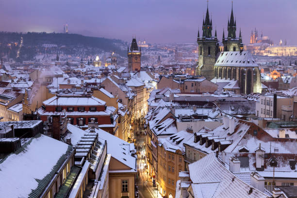 Winter in Prague - city panorama with Tyn Cathedral and Clock Tower Winter in Prague - city panorama with Tyn Cathedral and Clock Tower. Prague, Bohemia, Czech Republic. tyn church stock pictures, royalty-free photos & images