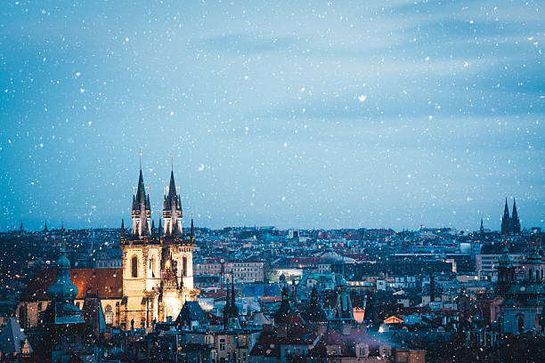 Winter In Prague Illuminated Týn church in Prague (Czech Republic) on a snowy Christams evening. tyn church stock pictures, royalty-free photos & images