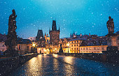 Charles Bridge in Prague on a snowy Christmas morning.