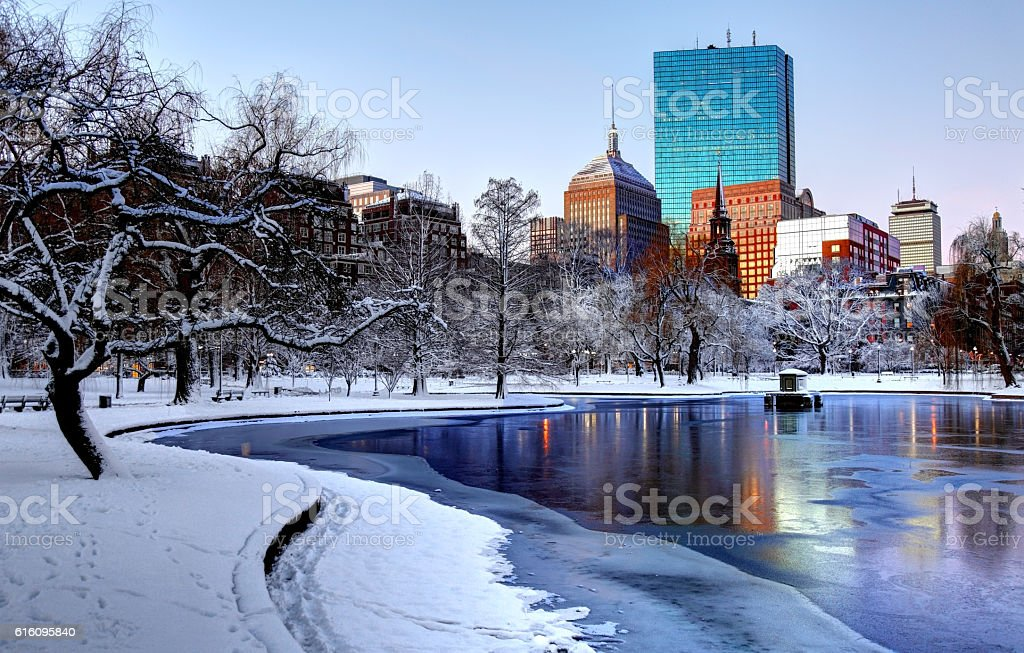 Winter in the Boston Public Garden Snow covered Boston Public Garden. Boston is the largest city in New England, the capital of the state of Massachusetts. Boston is known for its central role in American history,world-class educational institutions, cultural facilities, and champion sports franchises. Back Bay - Boston Stock Photo