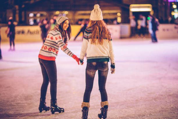 Winter is for fun Friends in ice rink having fun ice skating stock pictures, royalty-free photos & images