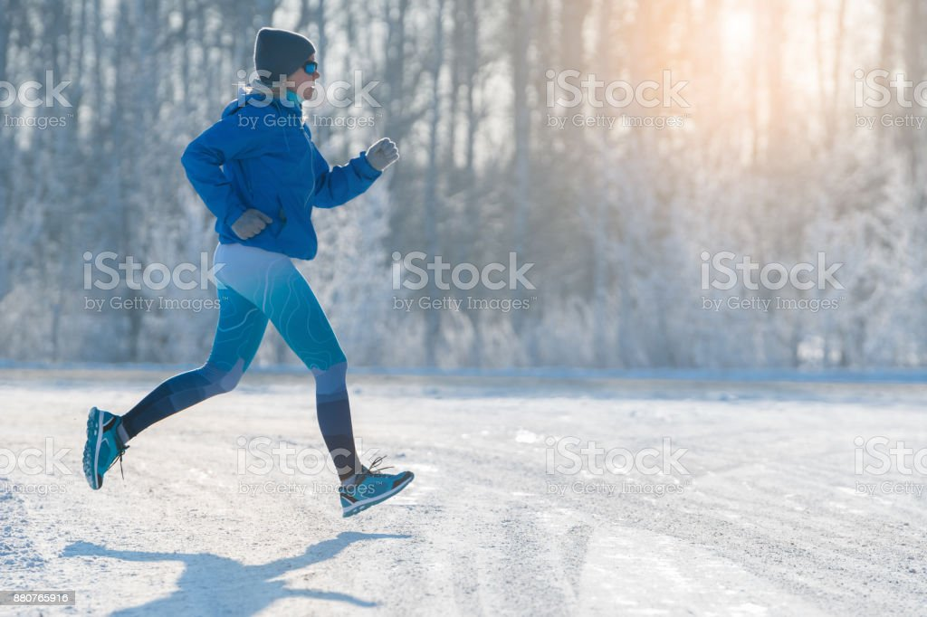 Winter Jogging - Winter Running in Snow. A healthy lifestyle. stock photo