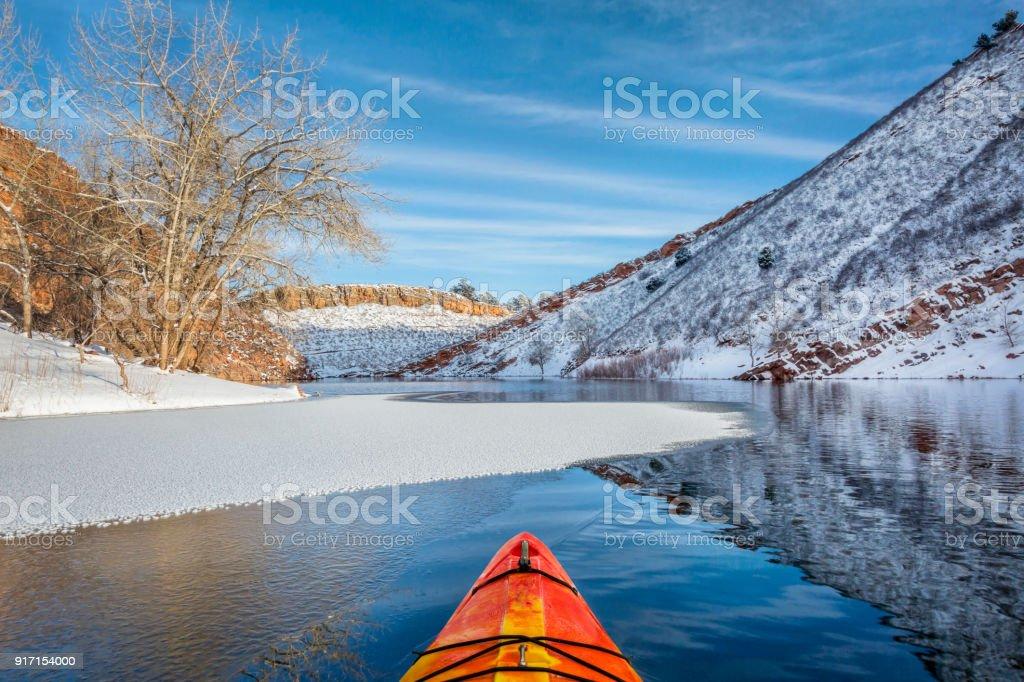 winter kayak paddling in Colorado stock photo