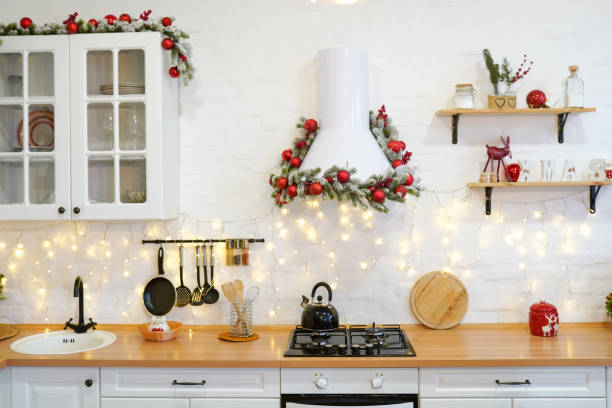 winter kitchen with red decorations, christmas cooking table and utensils - vacations food stock pictures, royalty-free photos & images